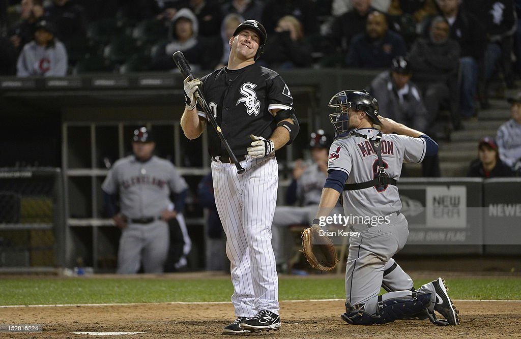 <a gi-track='captionPersonalityLinkClicked' href=/galleries/search?phrase=Kevin+Youkilis&family=editorial&specificpeople=206888 ng-click='$event.stopPropagation()'>Kevin Youkilis</a> #20 of the Chicago White Sox reacts after swinging and missing as catcher <a gi-track='captionPersonalityLinkClicked' href=/galleries/search?phrase=Lou+Marson&family=editorial&specificpeople=4175358 ng-click='$event.stopPropagation()'>Lou Marson</a> #6 of the Cleveland Indians throws the ball back to the pitcher during the ninth inning at U.S. Cellular Field on September 26, 2012 in Chicago, Illinois. Youkilis grounded into a double play in his at bat. The Indians defeated the White Sox 6-4.