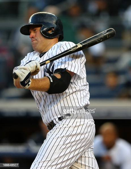 Kevin Youkilis of the New York Yankees follows through on a swing against the Baltimore Orioles on April 13 2013 at Yankee Stadium in the Bronx...