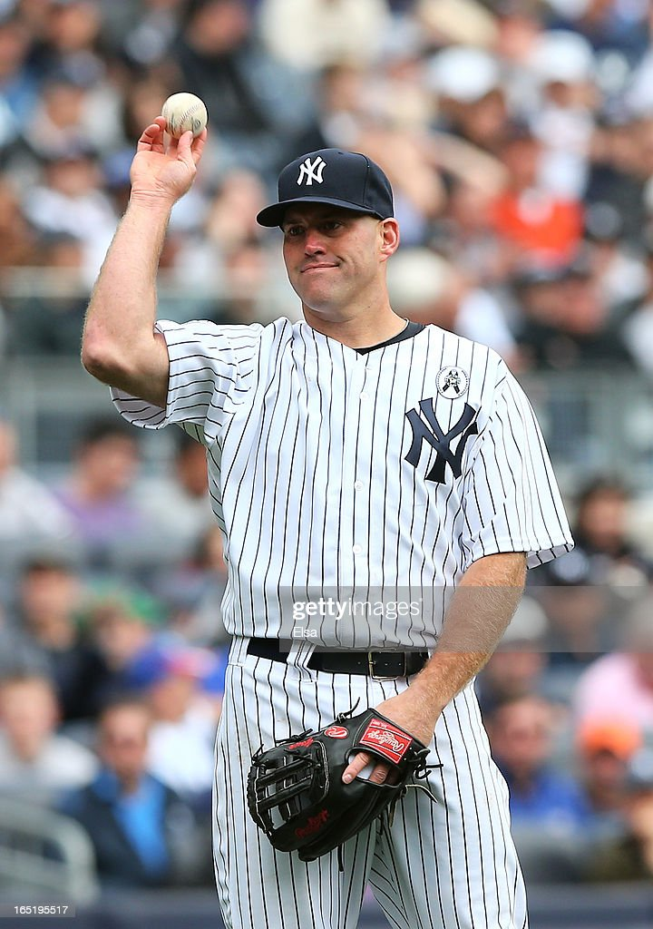 Kevin Youkilis #36 of the New York Yankees reacts after he fields the ball but no one was there to cover the base against the Boston Red Sox during Opening Day on April 1, 2013 at Yankee Stadium in the Bronx borough of New York City.