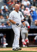 Kevin Youkilis of the New York Yankees reacts after he strikes out to end the seventh inning against the Boston Red Sox during Opening Day on April 1...