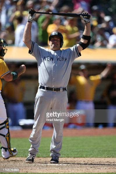Kevin Youkilis of the New York Yankees reacts after striking out against the Oakland Athletics during the game at Oco Coliseum on Thursday June 13...