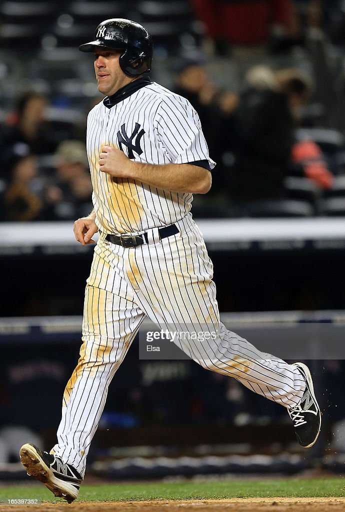 <a gi-track='captionPersonalityLinkClicked' href=/galleries/search?phrase=Kevin+Youkilis&family=editorial&specificpeople=206888 ng-click='$event.stopPropagation()'>Kevin Youkilis</a> #36 of the New York Yankees scores on home run by teammate Vernon Wells in the eighth inning against the Boston Red Sox on April 3, 2013 at Yankee Stadium in the Bronx borough of New York City.