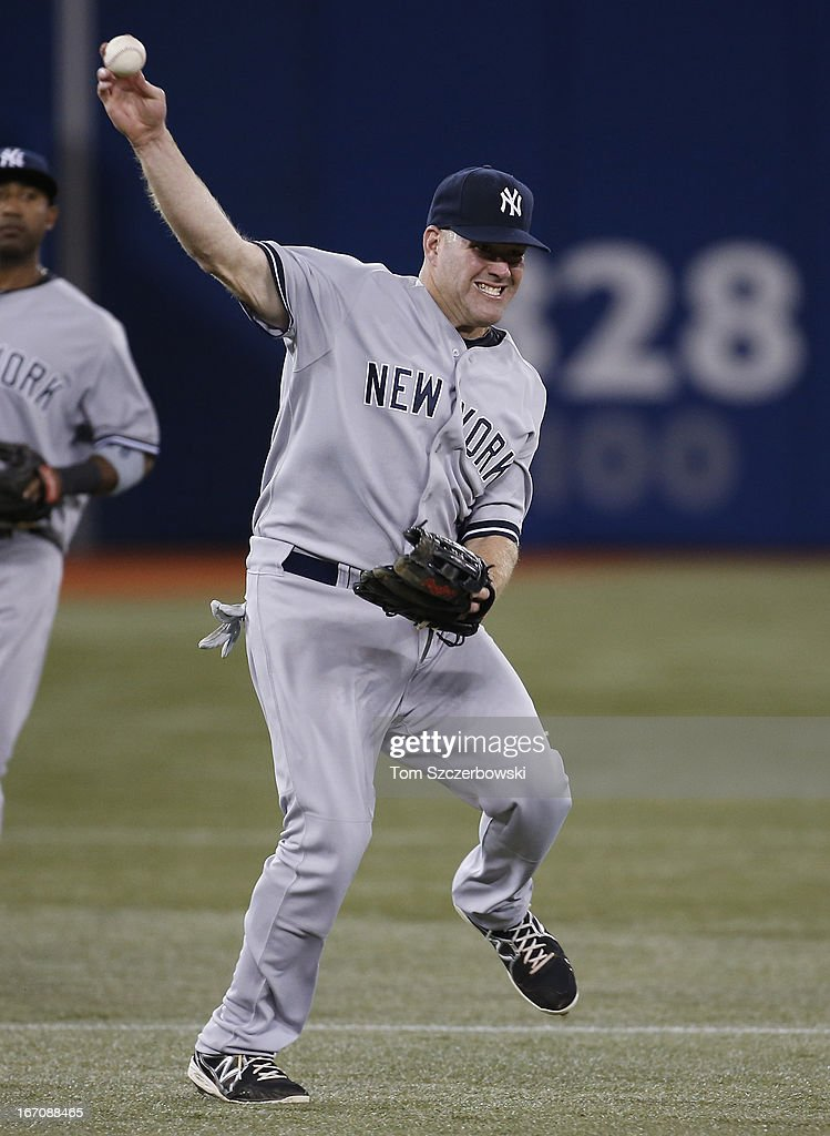 <a gi-track='captionPersonalityLinkClicked' href=/galleries/search?phrase=Kevin+Youkilis&family=editorial&specificpeople=206888 ng-click='$event.stopPropagation()'>Kevin Youkilis</a> #36 of the New York Yankees tries to throw out <a gi-track='captionPersonalityLinkClicked' href=/galleries/search?phrase=Brett+Lawrie&family=editorial&specificpeople=5496694 ng-click='$event.stopPropagation()'>Brett Lawrie</a> (not pictured) of the Toronto Blue Jays, who beat out the groundball for a single in the second inning during MLB game action on April 19, 2013 at Rogers Centre in Toronto, Ontario, Canada.