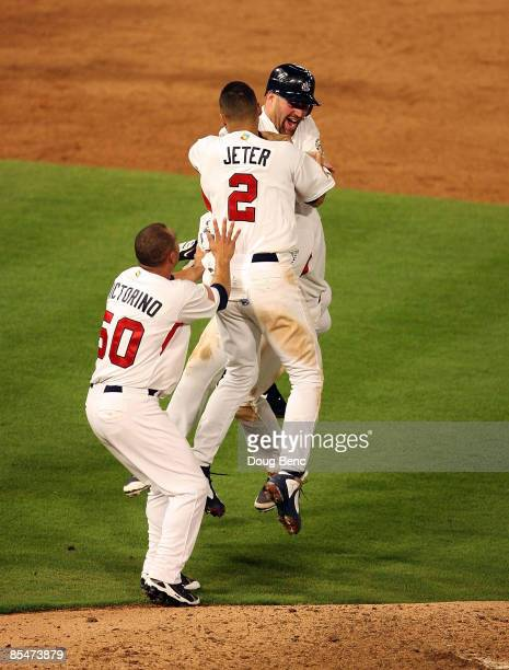 Kevin Youkilis Shane Victorino and Derek Jeter of United States jump on David Wright after Wright delivered the gamewinning hit in the bottom of the...