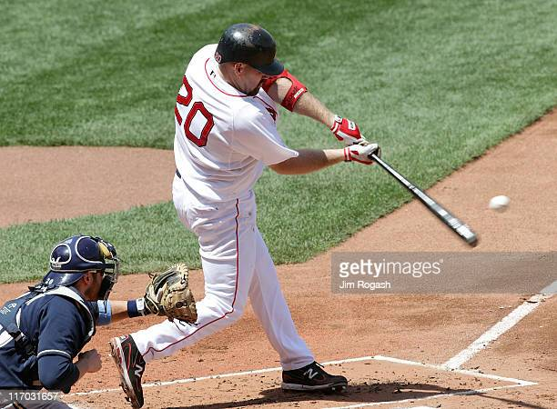 Kevin Youkillis of the Boston Red Sox connects for a threerun home run against the Milwaukee Brewers at Fenway Park on June 19 2011 in Boston...