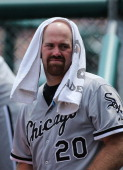 Kevin Youkillis of the Chicago White Sox tries to keep cool during the game against the Detroit Tigers at Comerica Park on July 22 2012 in Detroit...