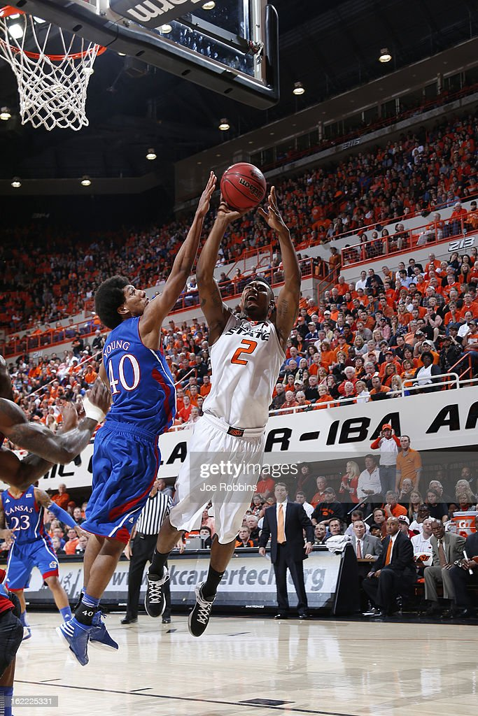 Kevin Young #40 of the Kansas Jayhawks blocks a shot against Le'Bryan Nash #2 of the Oklahoma State Cowboys during the game at Gallagher-Iba Arena on February 20, 2013 in Stillwater, Oklahoma. Kansas won 68-67 in two overtimes.