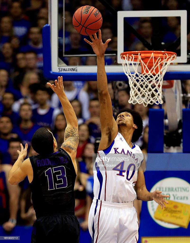 Kevin Young #40 of the Kansas Jayhawks blocks a shot by Angel Rodriguez #13 of the Kansas State Wildcats during the game at Allen Fieldhouse on February 11, 2013 in Lawrence, Kansas.