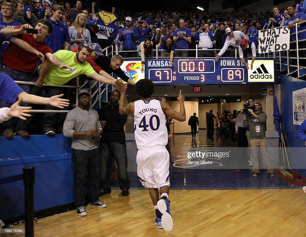 Kevin Young #40 of the Kansas Jayhawks celebrates with fans as he leaves the court after the Jayhawks defeated the Iowa State Cyclones 97-89 at Allen Fieldhouse on January 9, 2013 in Lawrence, Kansas.