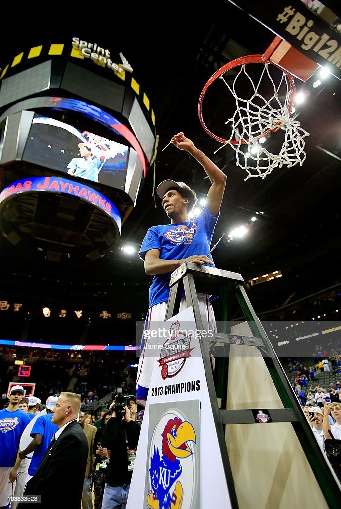 Kevin Young #40 of the Kansas Jayhawks cuts the net in celebration of their 70-54 victory over the Kansas State Wildcats during the Final of the Big 12 basketball tournament at Sprint Center on March 16, 2013 in Kansas City, Missouri.