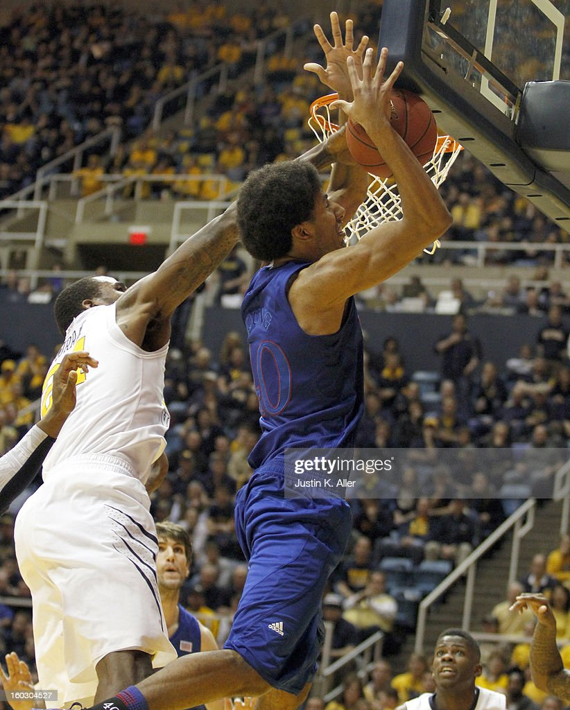 Kevin Young #40 of the Kansas Jayhawks is fouled by Aaric Murray #24 of the West Virginia Mountaineers at the WVU Coliseum on January 28, 2013 in Morgantown, West Virginia. The Jayhawks defeated WVU 61-56.