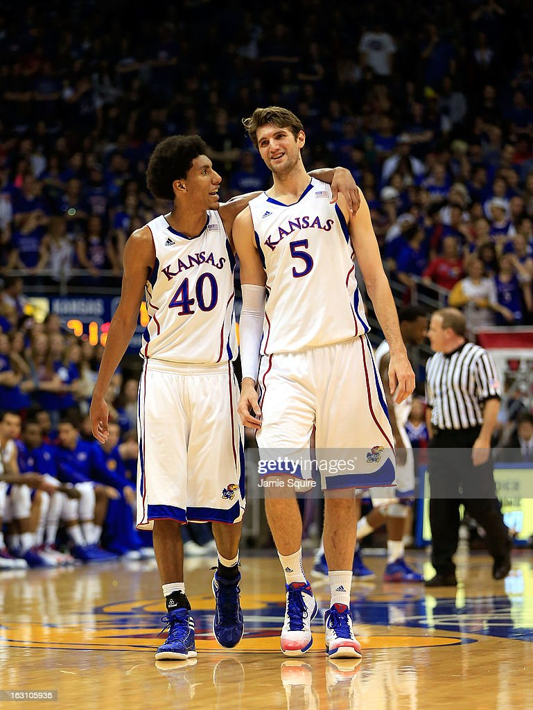 Kevin Young #40 of the Kansas Jayhawks puts his arm around Jeff Withey #5 as they walk onto the court after a timeout during the game against the Texas Tech Red Raiders at Allen Fieldhouse on March 4, 2013 in Lawrence, Kansas.