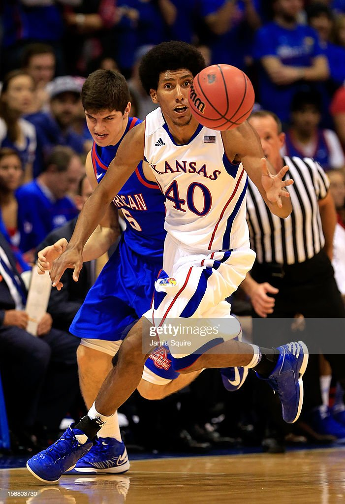 Kevin Young #40 of the Kansas Jayhawks steals the ball from Marko Vasic #5 of the American University Eagles during the game at Allen Fieldhouse on December 29, 2012 in Lawrence, Kansas.