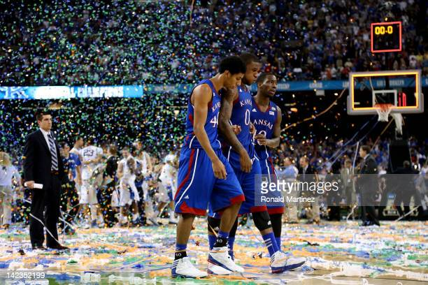 Kevin Young Thomas Robinson and Tyshawn Taylor of the Kansas Jayhawks walk off the court after losing to the Kentucky Wildcats 6759 in the National...