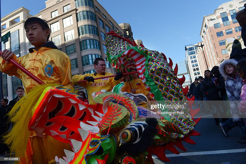 Kevin Yu, left, and other members of the New World Bilingual Institute Dragon Dance Team perform during a parade to celebrate the Chinese New Year on Sunday February 10, 2013 in Washington, DC. Scores of people turned out for the event that ushers in the year of the Snake.