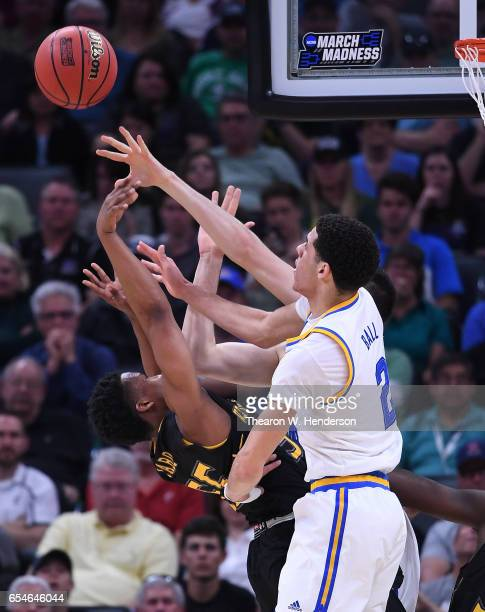 Kevin Zabo of the Kent State Golden Flashes is defended by Lonzo Ball of the UCLA Bruins during the first round of the 2017 NCAA Men's Basketball...