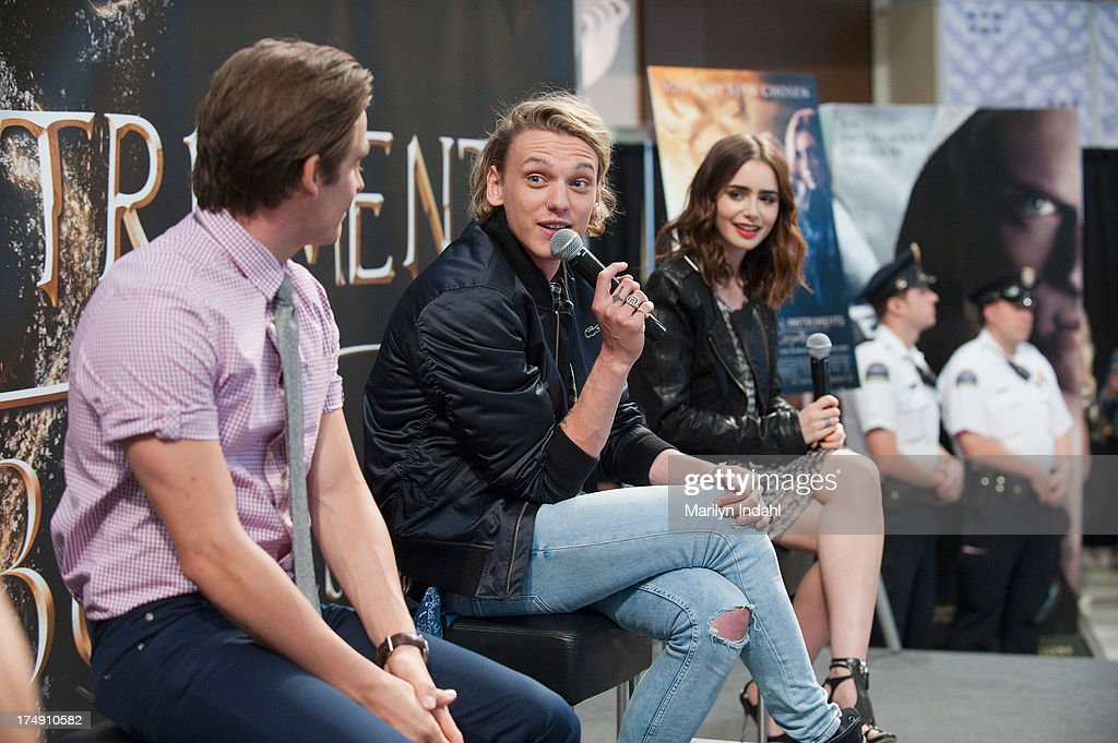 Kevin Zeger (L) <a gi-track='captionPersonalityLinkClicked' href=/galleries/search?phrase=Jamie+Campbell+Bower&family=editorial&specificpeople=4586724 ng-click='$event.stopPropagation()'>Jamie Campbell Bower</a> (C) and <a gi-track='captionPersonalityLinkClicked' href=/galleries/search?phrase=Lily+Collins&family=editorial&specificpeople=3520243 ng-click='$event.stopPropagation()'>Lily Collins</a> at the Mall of America for a meet and greet for fans in anticipation for Screen Gems's action-fantasy