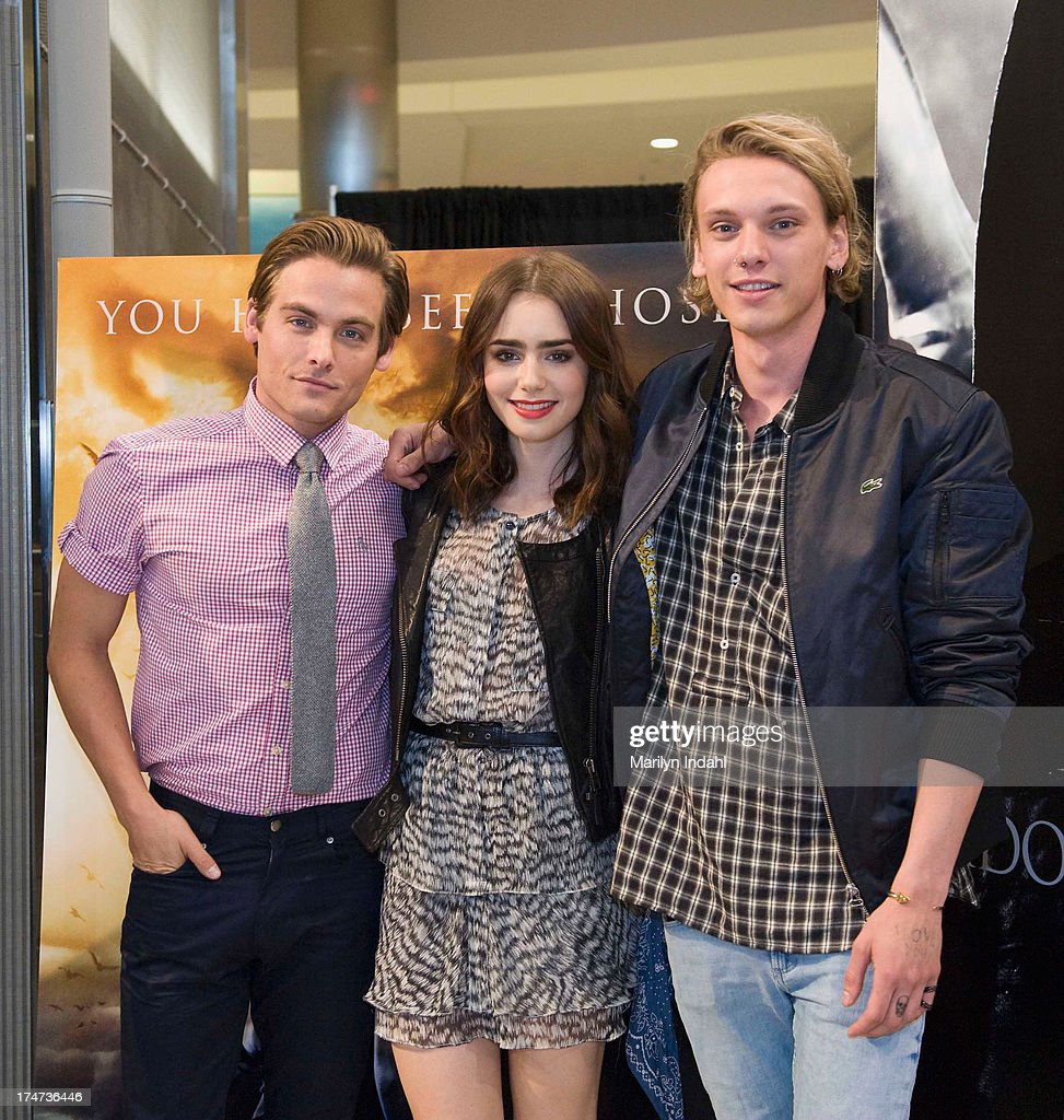 Kevin Zeger, <a gi-track='captionPersonalityLinkClicked' href=/galleries/search?phrase=Lily+Collins&family=editorial&specificpeople=3520243 ng-click='$event.stopPropagation()'>Lily Collins</a> and <a gi-track='captionPersonalityLinkClicked' href=/galleries/search?phrase=Jamie+Campbell+Bower&family=editorial&specificpeople=4586724 ng-click='$event.stopPropagation()'>Jamie Campbell Bower</a> of Screen Gems's action-fantasy THE MORTAL INSTRUMENTS at Mall of America on July 28, 2013 in Bloomington, Minnesota.
