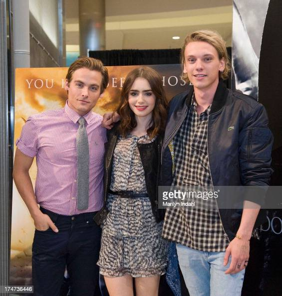 Kevin Zeger Lily Collins and Jamie Campbell Bower of Screen Gems's actionfantasy THE MORTAL INSTRUMENTS at Mall of America on July 28 2013 in...