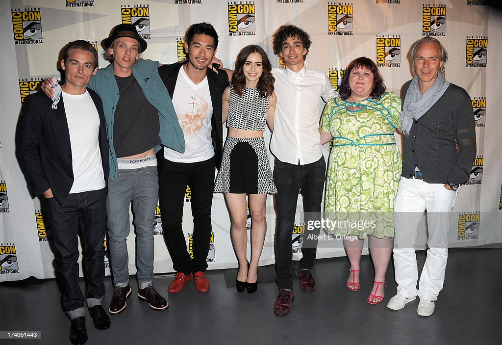 Kevin Zegers, Jamie Campbell Bower and Lily Collins, author Cassandra Clare, actors Robert Sheehan and Godfrey Gao, and director Harald Zwartattend the Sony and Screen Gems panel during Comic-Con International 2013 at San Diego Convention Center on July 19, 2013 in San Diego, California.