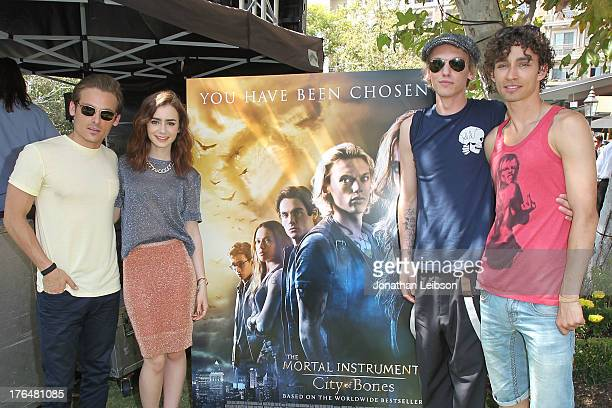Kevin Zegers Lily Collins Jamie Campbell Bower and 'The Mortal Instruments City Of Bones' meet and greet at The Americana at Brand on August 13 2013...