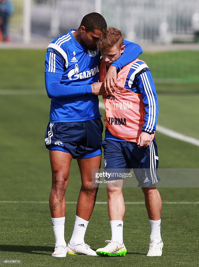 KevinPrince Boateng hugs Max Meyer during day 7 of the FC Schalke 04 training camp at the ASPIRE Academy for Sports Excellence on January 12 2015 in...