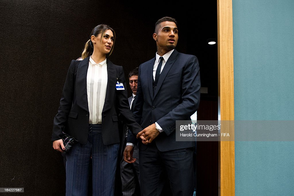 <a gi-track='captionPersonalityLinkClicked' href=/galleries/search?phrase=Kevin-Prince+Boateng&family=editorial&specificpeople=613049 ng-click='$event.stopPropagation()'>Kevin-Prince Boateng</a> (R) of AC Milan and Ghana looks on with his girlfriend <a gi-track='captionPersonalityLinkClicked' href=/galleries/search?phrase=Melissa+Satta&family=editorial&specificpeople=2083016 ng-click='$event.stopPropagation()'>Melissa Satta</a> after the discussion panel on the International Day for the Elimination of Racial Discrimination at United Nations Office in Geneva on March 21, 2013 in Geneva, Switzerland. On the United Nations' (UN) International Day for the Elimination of Racial Discrimination, the Office of the High Commissioner for Human Rights (OHCHR) see today as a unique opportunity to celebrate diversity and urged all sportswomen and sportsmen, sports authorities and fans to take decisive action against intolerance and racism in sports and celebrate human achievement and excellence beyond the narrow boundaries of ethnicity, race or nationality.