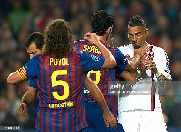 KevinPrince Boateng of AC Milan argues with Daniel Alves and Sergio Busquets of FC Barcelona during the UEFA Champions League quarterfinal second leg...