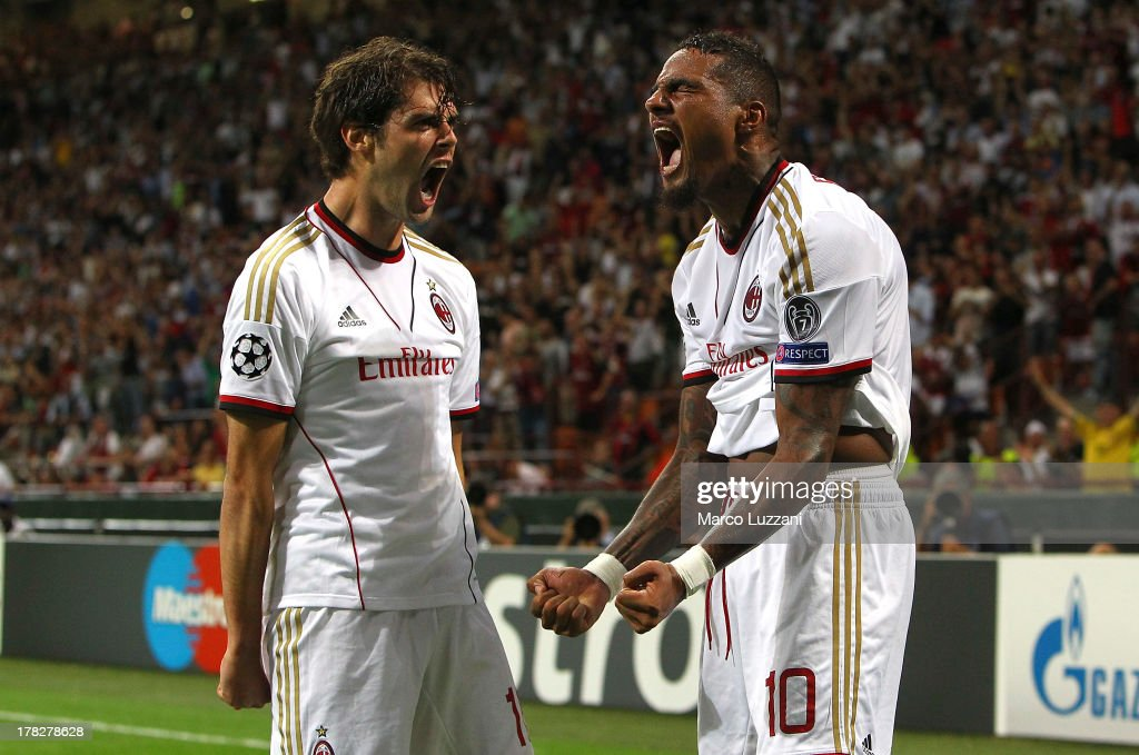 <a gi-track='captionPersonalityLinkClicked' href=/galleries/search?phrase=Kevin-Prince+Boateng&family=editorial&specificpeople=613049 ng-click='$event.stopPropagation()'>Kevin-Prince Boateng</a> (R) of AC Milan celebrates his second goal with team-mate Abdrea Poli (L) during the UEFA Champions League Play Off Second leg match between AC Milan and PSV Eindhoven at Stadio Giuseppe Meazza on August 28, 2013 in Milan, Italy.