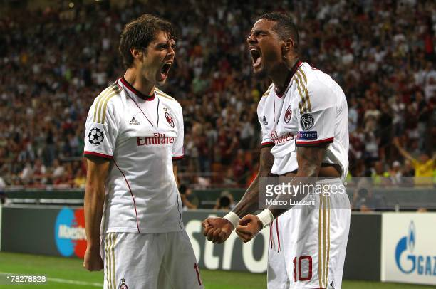 KevinPrince Boateng of AC Milan celebrates his second goal with teammate Abdrea Poli during the UEFA Champions League Play Off Second leg match...