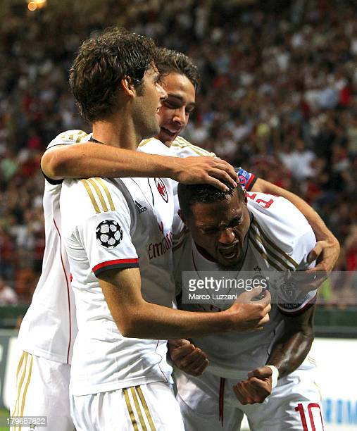 KevinPrince Boateng of AC Milan celebrates his second goal with teammate Andrea Poli and Mattia De Sciglio during the UEFA Champions League Play Off...