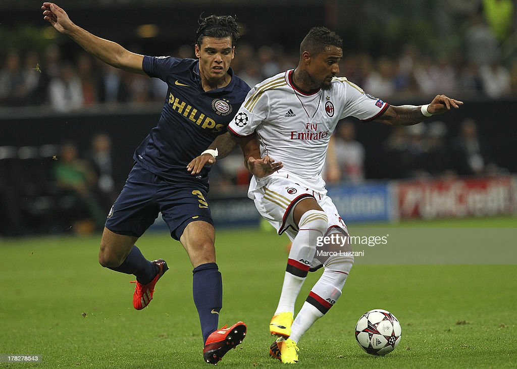 <a gi-track='captionPersonalityLinkClicked' href=/galleries/search?phrase=Kevin-Prince+Boateng&family=editorial&specificpeople=613049 ng-click='$event.stopPropagation()'>Kevin-Prince Boateng</a> (R) of AC Milan competes for the ball with Karim Rekik (L) of PSV E indhoven during the UEFA Champions League Play Off Second leg match between AC Milan and PSV Eindhoven at Stadio Giuseppe Meazza on August 28, 2013 in Milan, Italy.