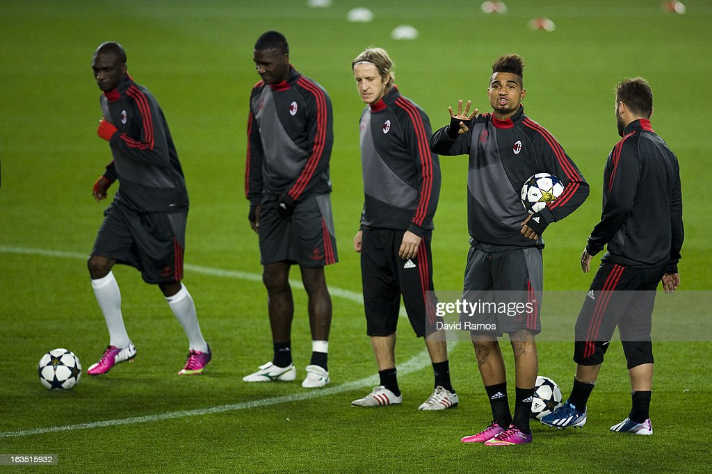 <a gi-track='captionPersonalityLinkClicked' href=/galleries/search?phrase=Kevin-Prince+Boateng&family=editorial&specificpeople=613049 ng-click='$event.stopPropagation()'>Kevin-Prince Boateng</a> of AC Milan (2nd R) reacts during a training session ahead of their UEFA Champions League round of 16 second leg against FC Barcelona at the Camp Nou Stadium on March 11, 2013 in Barcelona, Spain.