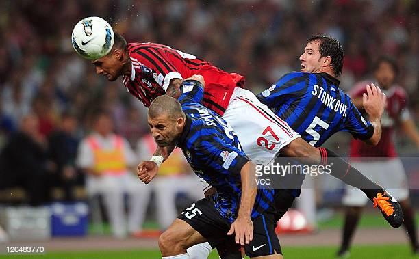 KevinPrince Boateng of AC Milan rises above Samuel Walter Adrian of Inter Milan during the Italy Super Cup Final match between AC Milan and Inter...
