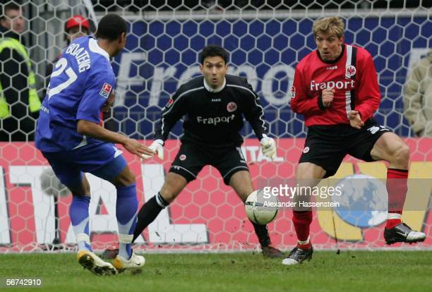 KevinPrince Boateng of Berlin scores the first goal whilst Keeper Oka Nikolov and his team mate Marko Rehmer of Frankfurt looking on during the...