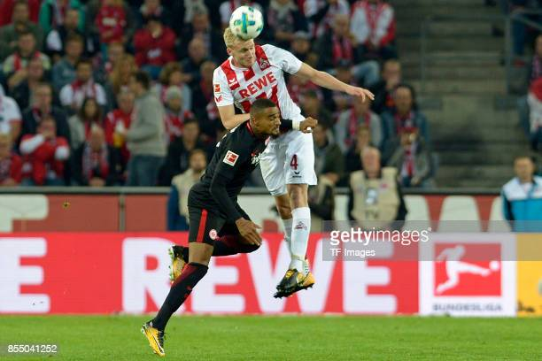 KevinPrince Boateng of Frankfurt and Frederik Sörensen of Koeln battle for the ball during the Bundesliga match between 1 FC Koeln and Eintracht...