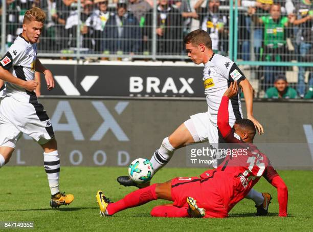 KevinPrince Boateng of Frankfurt and Matthias Ginter of Moenchengladbach battle for the ball during the Bundesliga match between Borussia...