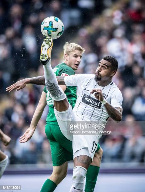 KevinPrince Boateng of Frankfurt is tackled by Martin Hinteregger of Augsburg during the Bundesliga match between Eintracht Frankfurt and FC Augsburg...