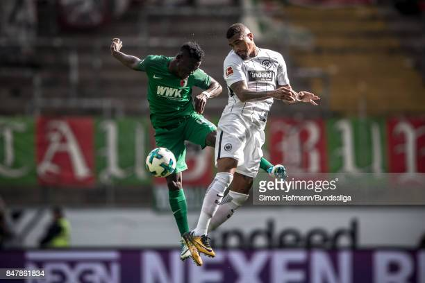 KevinPrince Boateng of Frankfurt jumps for a header with Daniel Opare of Augsburg during the Bundesliga match between Eintracht Frankfurt and FC...