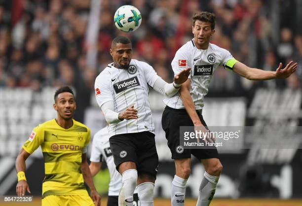 KevinPrince Boateng of Frankfurt jumps for a header with David Abraham of Frankfurt and PierreEmerick Aubameyang of Dortmund during the Bundesliga...