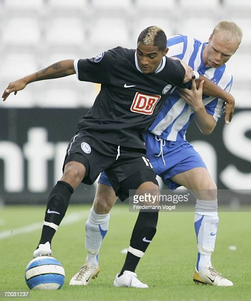 KevinPrince Boateng of Hertha tussles for the ball with Jan Tore Ophaug of Odense during the UEFA Cup second leg match between Odense BK and Hertha...