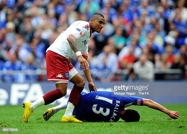 KevinPrince Boateng of Portsmouth checks on Michael Ballack of Chelsea after fouling him during the FA Cup sponsored by EON Final match between...