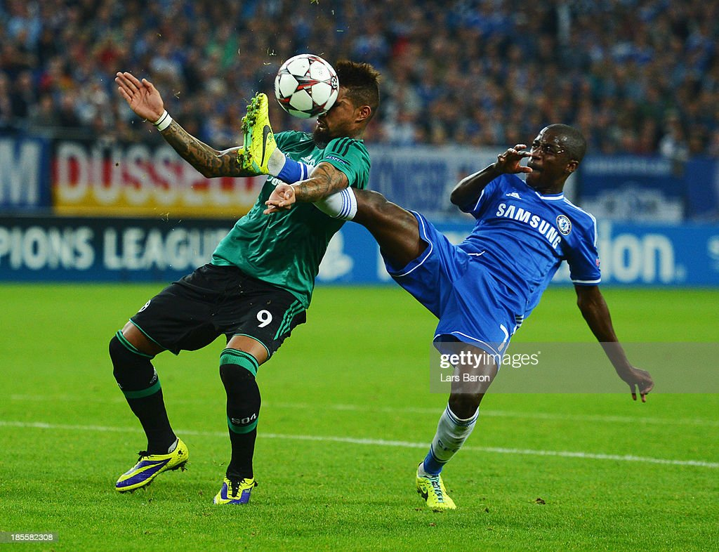 <a gi-track='captionPersonalityLinkClicked' href=/galleries/search?phrase=Kevin-Prince+Boateng&family=editorial&specificpeople=613049 ng-click='$event.stopPropagation()'>Kevin-Prince Boateng</a> of Schalke 04 is challenged by Ramires of Chelsea during the UEFA Champions League Group E match between FC Schalke 04 and Chelsea at Veltins-Arena on October 22, 2013 in Gelsenkirchen, Germany.