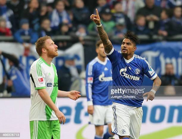 KevinPrince Boateng of Schalke celebrates after scoring beside Patrick Ochs of Wolfsburg during the Bundesliga match between FC Schalke 04 and VfL...
