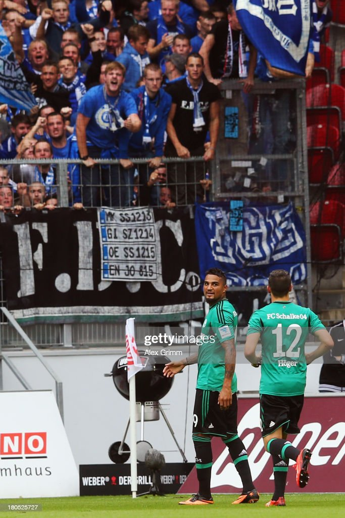 KevinPrince Boateng of Schalke celebrates his team's first goal with team mate Marco Hoeger during the Bundesliga match between 1 FSV Mainz 05 and FC...