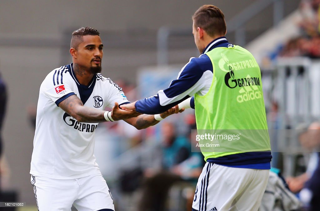 KevinPrince Boateng of Schalke celebrates his team's first goal with team mate Adam Szalai during the Bundesliga match between 1899 Hoffenheim and FC...