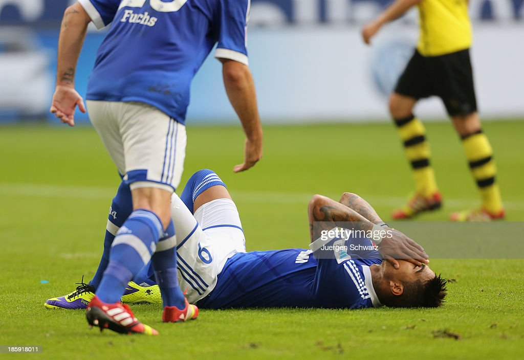 KevinPrince Boateng of Schalke covers his face after missing to score by penalty during the Bundesliga match between Schalke 04 and Borussia Dortmund...