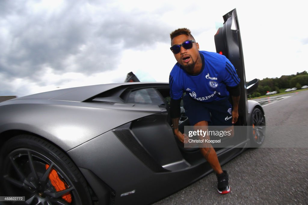 KevinPrince Boateng of Schalke gets out of a Lamborghini during a test drive at driving safety centre Rheinberg on August 12 2014 in Rheinberg Germany