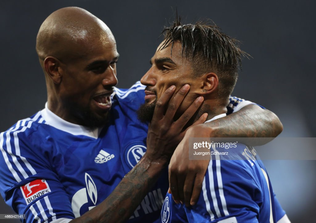 <a gi-track='captionPersonalityLinkClicked' href=/galleries/search?phrase=Kevin-Prince+Boateng&family=editorial&specificpeople=613049 ng-click='$event.stopPropagation()'>Kevin-Prince Boateng</a> of Schalke (R) his hugged by <a gi-track='captionPersonalityLinkClicked' href=/galleries/search?phrase=Felipe+Santana&family=editorial&specificpeople=5422021 ng-click='$event.stopPropagation()'>Felipe Santana</a> after scoring his second goal during the Bundesliga match between FC Schalke 04 and VfL Wolfsburg at Veltins-Arena on February 1, 2014 in Gelsenkirchen, Germany.