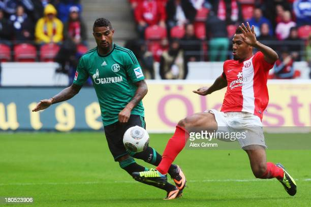 KevinPrince Boateng of Schalke is challenged by EricMaxim ChoupoMoting of Mainz during the Bundesliga match between 1 FSV Mainz 05 and FC Schalke 04...